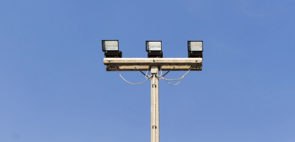 Floodlights shining down from a tall light pole