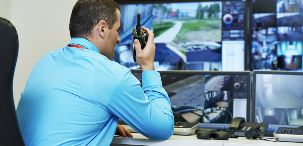 Security officer monitoring commercial property