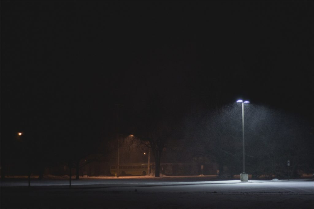 Parking lot with snow and light pole