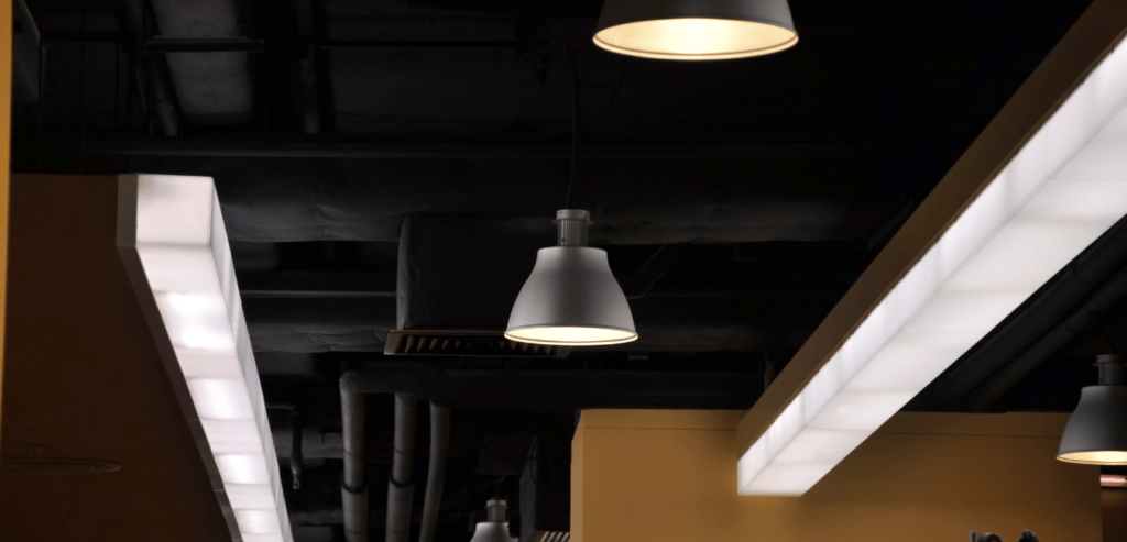 round and linear high bay lights in commercial office